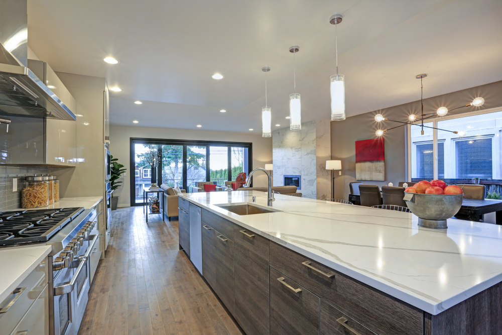 three bulbs lighting up kitchen island