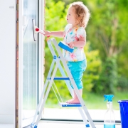 Chilld cleaning windows