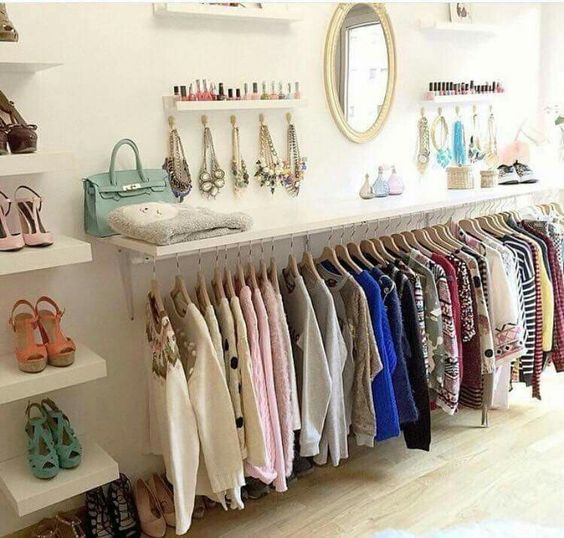 shelf and clothes underneath