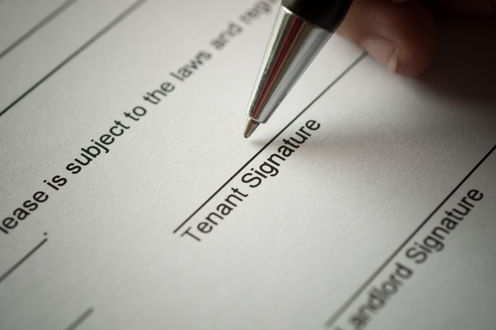 tenant signing paper