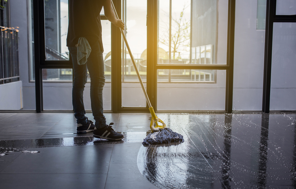 wash the floor with a mop